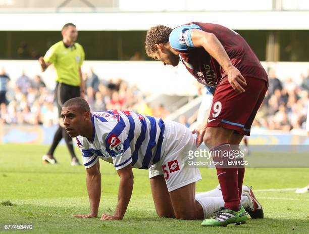 Aston Villa's Stiliyan Petrov gives Queens Park Rangers' Anton Ferdinand a nudge