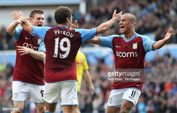Aston Villa's Stiliyan Petrov is congratulated by team mates Gabriel Agbonlahor and James Milner after he scores the opening goal of the game