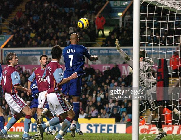 Aston Villa's Thomas Sorensen scrambles to save Everton's Marcus Bent's header