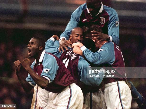 Aston Villa's Ugo Ehiogu celebrates to the crowd while teammates jump on Juulian Joachim after he scored the equalizer during this afternoon's...