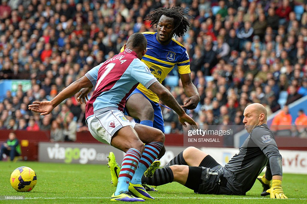 Aston Villa's US goalkeeper Brad Guzan (R) and Dutch midfielder Leandro Bacuna (L) fend off Everton's Belgian striker Romelu Lukaku (C) during the English Premier League football match between Aston Villa and Everton at Villa Park in Birmingham on October 26, 2013. USE. No use with unauthorized audio, video, data, fixture lists, club/league logos or live services. Online in-match use limited to 45 images, no video emulation. No use in betting, games or single club/league/player publications.