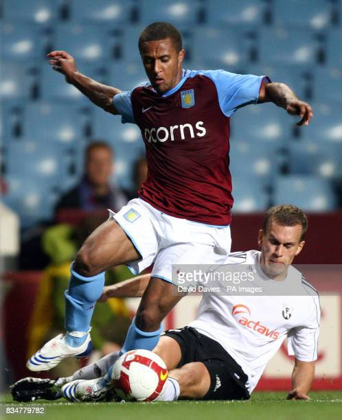Aston Villa's Wayne Routledge is tackled by FH Hafnarfjordur's Hjortur Valgardsson during the UEFA Cup Qualifying Round Two Second Leg match at Villa...