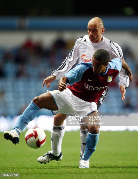 Aston Villa's Wayne Routledge is tackled by FH Hafnarfjordur's Tryggvi Gudmundsson during the UEFA Cup Qualifying Round Two Second Leg match at Villa...