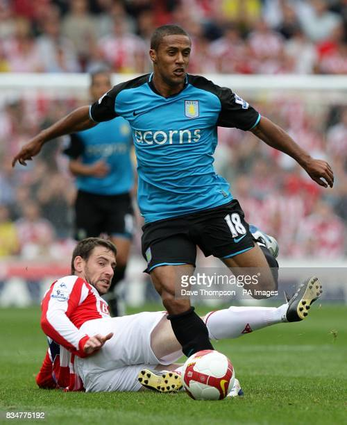 Aston Villa's Wayne Routledge jumps a tackle from Stoke City Rory Delap
