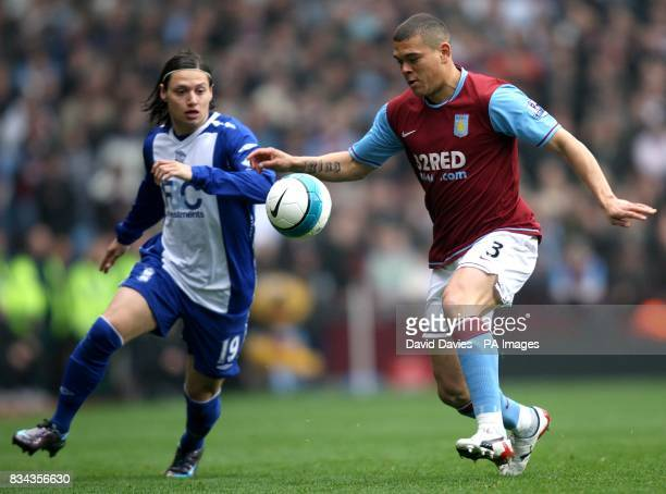 Aston Villa's Wilfred Bouma and Birmingham City's Mauro Zarate battle for the ball