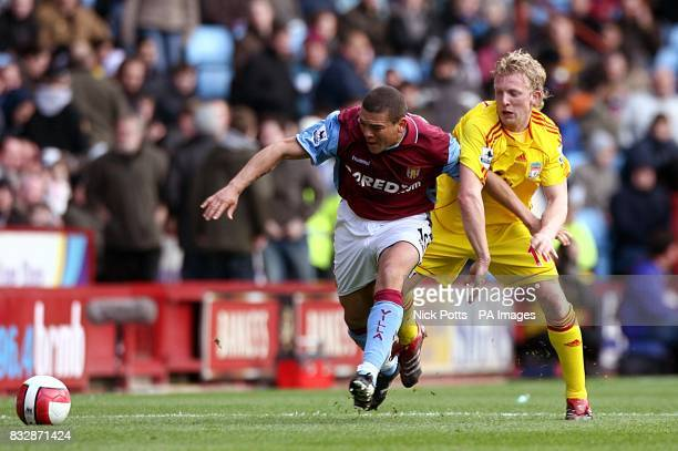 Aston Villa's Wilfred Bouma and Liverpool's Dirk Kuyt