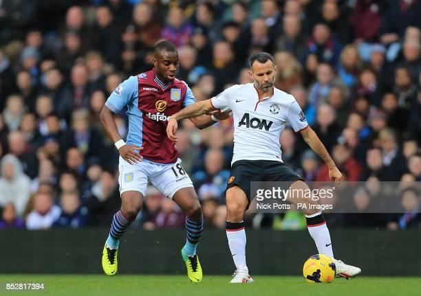 Aston Villa's Yacouba Sylla and Manchester United's Ryan Giggs battle for the ball