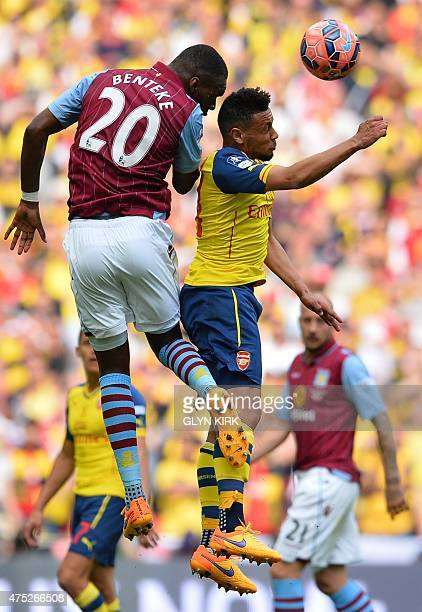 Aston Villa's Zaireborn Belgian striker Christian Benteke jumps for a header with Arsenal's French midfielder Francis Coquelin during the FA Cup...
