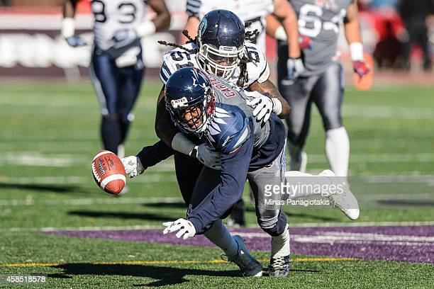 Aston Whiteside of the Toronto Argonauts tackles Duron Carter of the Montreal Alouettes during the CFL game at Percival Molson Stadium on November 2...
