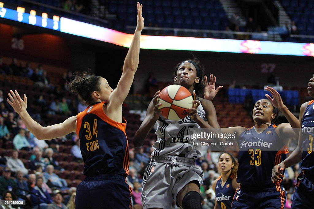 Astou Ndour #45, (center), of the San Antonio Stars drives to the basket challenged by Kelly Faris #34, (left) and Morgan Tuck #33 of the Connecticut Sun during the San Antonio Stars Vs Connecticut Sun preseason WNBA game at Mohegan Sun Arena on May 05, 2016 in Uncasville, Connecticut.