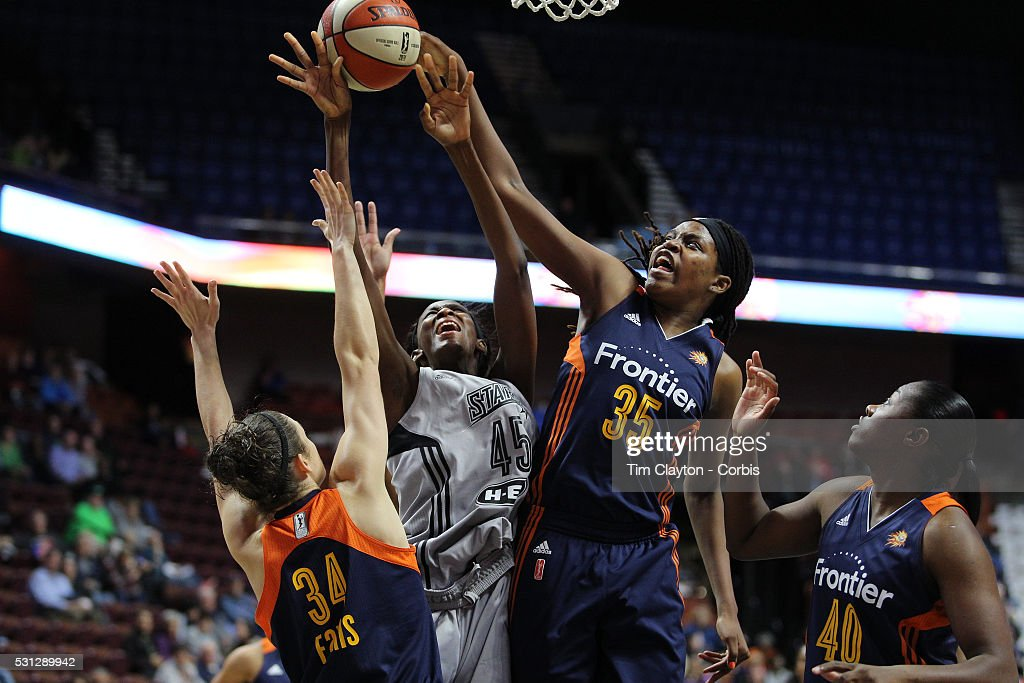 Astou Ndour #45, (center), of the San Antonio Stars drives to the basket challenged by Kelly Faris #34, (left) and Jonquel Jones #35 of the Connecticut Sun during the San Antonio Stars Vs Connecticut Sun preseason WNBA game at Mohegan Sun Arena on May 05, 2016 in Uncasville, Connecticut.