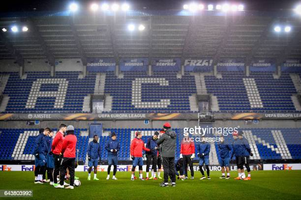 Astra Giurgiu's players attend a training session in Genk on February 22 2017 on the eve of the UEFA Europa League round of 32 football match between...