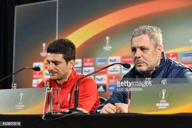 Astra Giurgiu's Romanian forward Daniel Niculae and Astra Giurgiu's head coach Marius Sumudica attend a press conference on February 22 in Genk on...