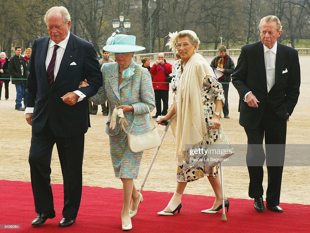 Astrid (in the blue dress) and Ragnhild, sisters of King Harald of Norway arrive with unidentified guests at the christening of Princess Ingrid Alexandra - daughter of Crown Prince Haakon and Crown Princess Mette-Marit at the chapel inside The Royal Palace on April 17, 2004 in Oslo, Norway. The Princess was born on January 21, 2004 and is second in line to the throne.