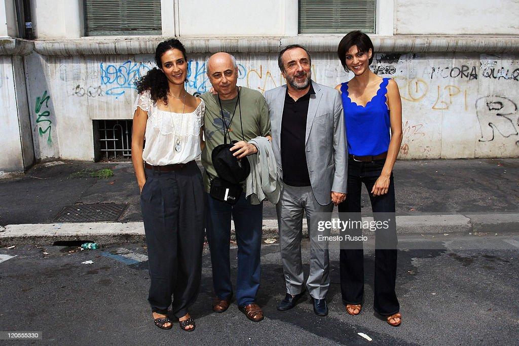 Astrid Meloni, director Roberto Faenza, Silvio Orlando, Giulia Bevilacqua attend the 'Il Delitto Di Via Poma' photocall Television Fiction on the set in Via Carlo Poma August 7, 2011 in Rome, Italy.
