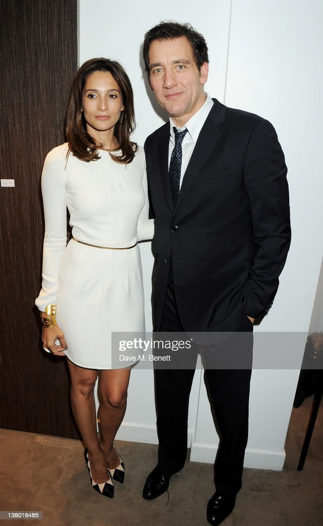 Astrid Munoz (L) and Clive Owen attend a private viewing of 'Gaucho', a photographic exhibition by Astrid Munoz, at the Jaeger-LeCoultre Boutique on January 31, 2012 in London, England.