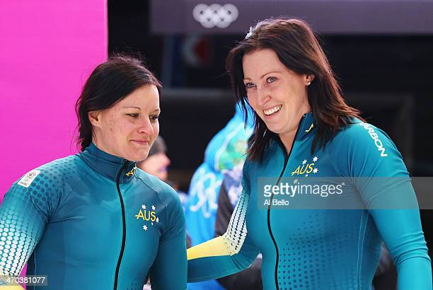Astrid Radjenovic and Jana Pittman of Australia team 1 look on during the Women's Bobsleigh on Day 12 of the Sochi 2014 Winter Olympics at Sliding...