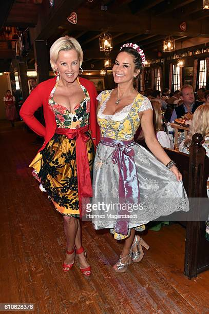 Astrid Soell and Gitta Saxx attend the Charity Lunch at 'Zur Bratwurst' during the Oktoberfest 2016 on September 27 2016 in Munich Germany