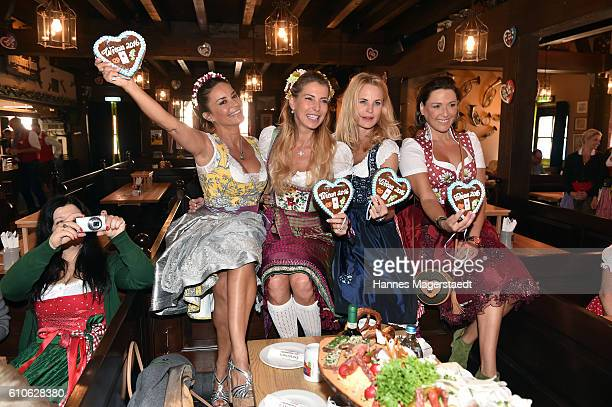 Astrid Soell and Gitta Saxx Giulia Siegel Sonja Kiefer and Simone Ballack attend the Charity Lunch at 'Zur Bratwurst' during the Oktoberfest 2016 on...