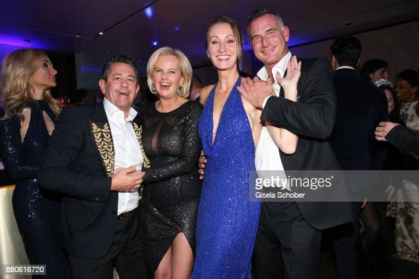 Astrid Soell dirndl fashion designer and her husband Volker Woehrle Renata Kochta and her husband Thomas Frank during the DressHeaven 2017 Christmas...