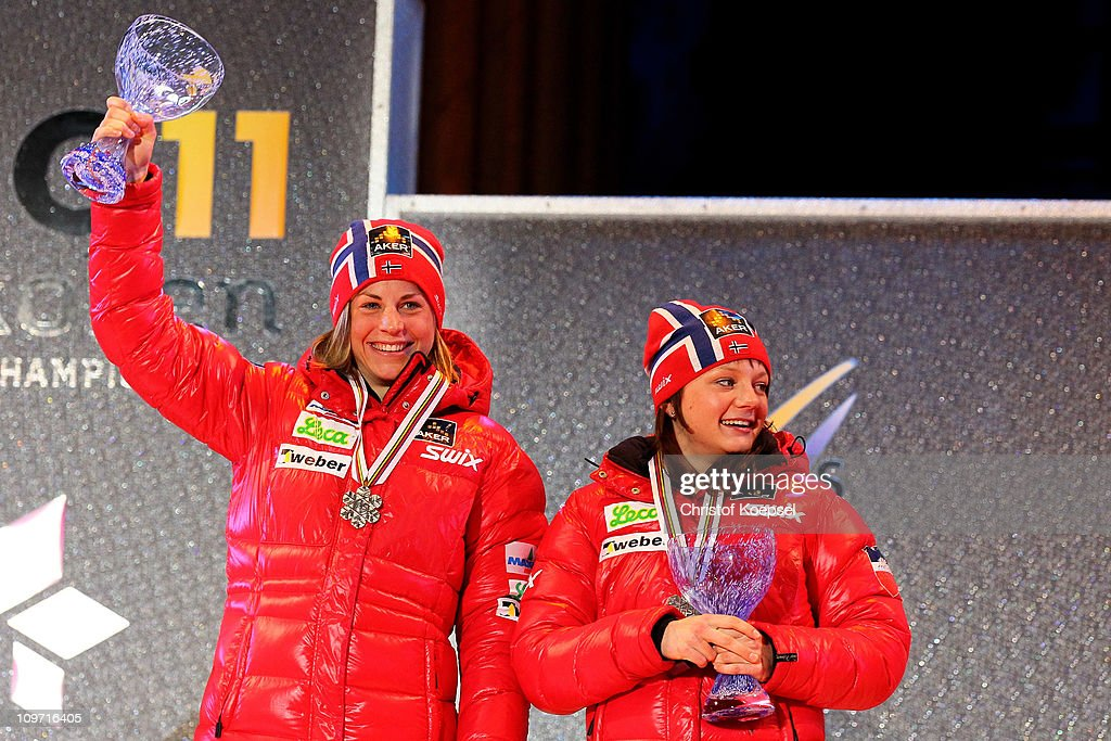 Astrid Uhrenholdt Jacobsen and Maiken Caspersen Falla of Norway pose with the bronze medals won in the Ladies Cross Country Team Sprint race during the FIS Nordic World Ski Championships at University Square on March 2, 2011 in Oslo, Norway.