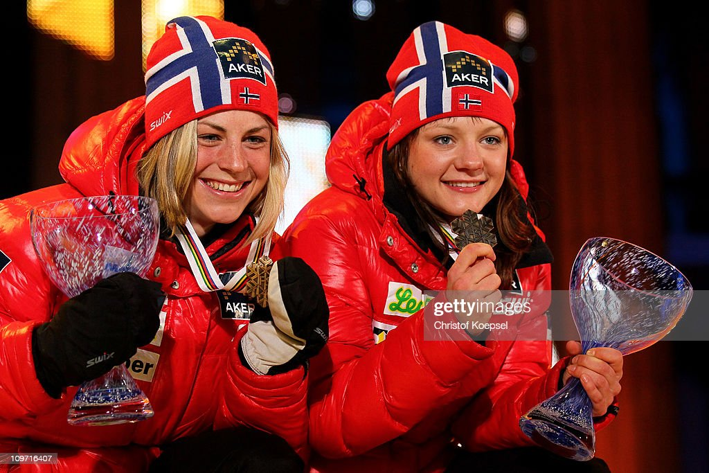 Astrid Uhrenholdt Jacobsen and Maiken Caspersen Falla of Norway pose with the bronze medals won in the Ladies Cross Country Team Sprint race during the FIS Nordic World Ski Championships at Holmenkollen on March 2, 2011 in Oslo, Norway.