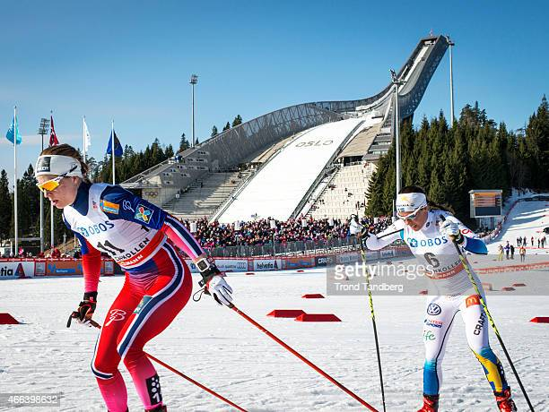 Astrid Uhrenholdt Jacobsen of Norway and Charlotte Kalla of Sweden compete during FIS World Cup Lady 30 km Mass Start Free on March 15 2015 in...