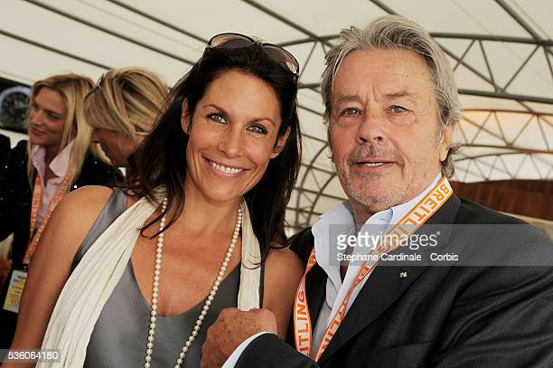 Astrid Veillon and Alain Delon attend the Breitling lunch during the 48th Paris Air Show held at Paris Le Bourget