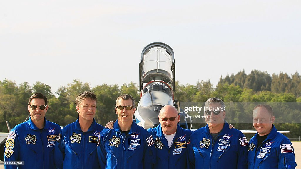 Astronaunts, Greg Chamitoff, European Space Agency, Roberto Vittori, Andrew Feustel, Commander <a gi-track='captionPersonalityLinkClicked' href=/galleries/search?phrase=Mark+Kelly+-+Astronaut+and+Gun+Control+Advocate&family=editorial&specificpeople=566699 ng-click='$event.stopPropagation()'>Mark Kelly</a>, Pilot Gregory H. Johnson and Mission Specialists Michael Fincke, pose for a picture after arriving at the shuttle landing facility for the Terminal Countdown Demonstration Test at Kennedy Space Spacecraft Center, on March 29, 2011 in Cape Canaveral, Florida. The TCDT will culminate in a full dress rehearsal for the planned April 19th launch of Space Shuttle Endeavour's final scheduled flight to the International Space Station before being retired.