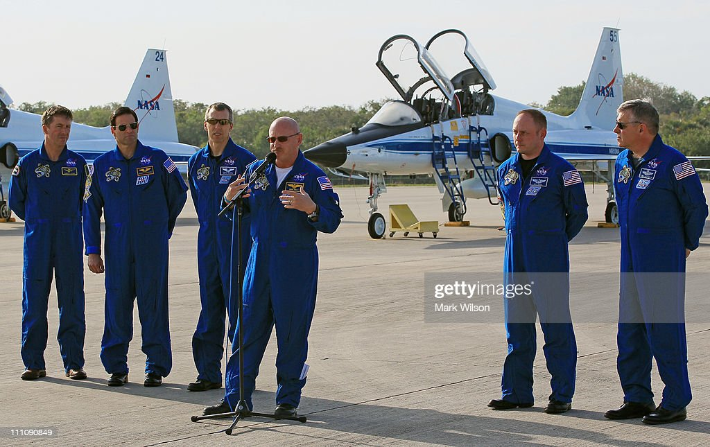 Astronaunts, Greg Chamitoff, European Space Agency's Roberto Vittori, Andrew Feustel, Commander <a gi-track='captionPersonalityLinkClicked' href=/galleries/search?phrase=Mark+Kelly+-+Astronaut+and+Gun+Control+Advocate&family=editorial&specificpeople=566699 ng-click='$event.stopPropagation()'>Mark Kelly</a>, Mission Specialists Michael Fincke and Pilot Gregory H. Johnson, speak to the media after arriving at the shuttle landing facility for the Terminal Countdown Demonstration Test at Kennedy Space Spacecraft Center, on March 29, 2011 in Cape Canaveral, Florida. The TCDT will culminate in a full dress rehearsal for the planned April 19th launch of Space Shuttle Endeavour's final scheduled flight to the International Space Station before being retired.