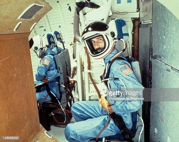 Astronaut A Nasa Astronaut In Space Suit Strapped Into Space Shuttle