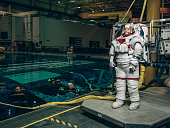 NASA astronaut Anne McClain who has been selected for a manned mission to Mars is photographed at the Neutral Buoyancy Laboratory for Paris Match at...