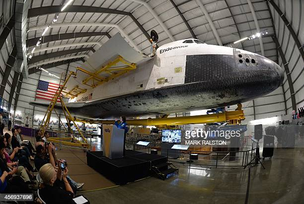 Astronaut Barbara Morgan speaks before workers install the final payload a configuration similar to the STS118 mission consisting of a flown SPACEHAB...