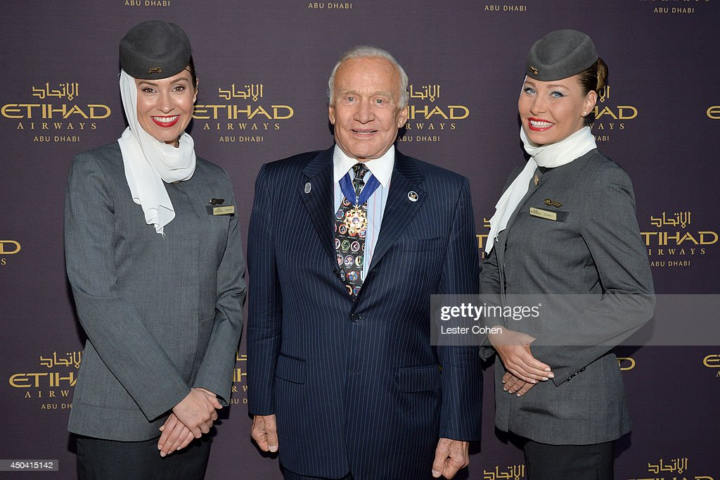Astronaut <a gi-track='captionPersonalityLinkClicked' href=/galleries/search?phrase=Buzz+Aldrin&family=editorial&specificpeople=90480 ng-click='$event.stopPropagation()'>Buzz Aldrin</a> (C) and Etihad Airways cabin crew attend a gala to celebrate Etihad Airways' world-class, non-stop service between Los Angeles and Abu Dhabi at the iconic Beverly House on June 10, 2014 in Beverly Hills, California.