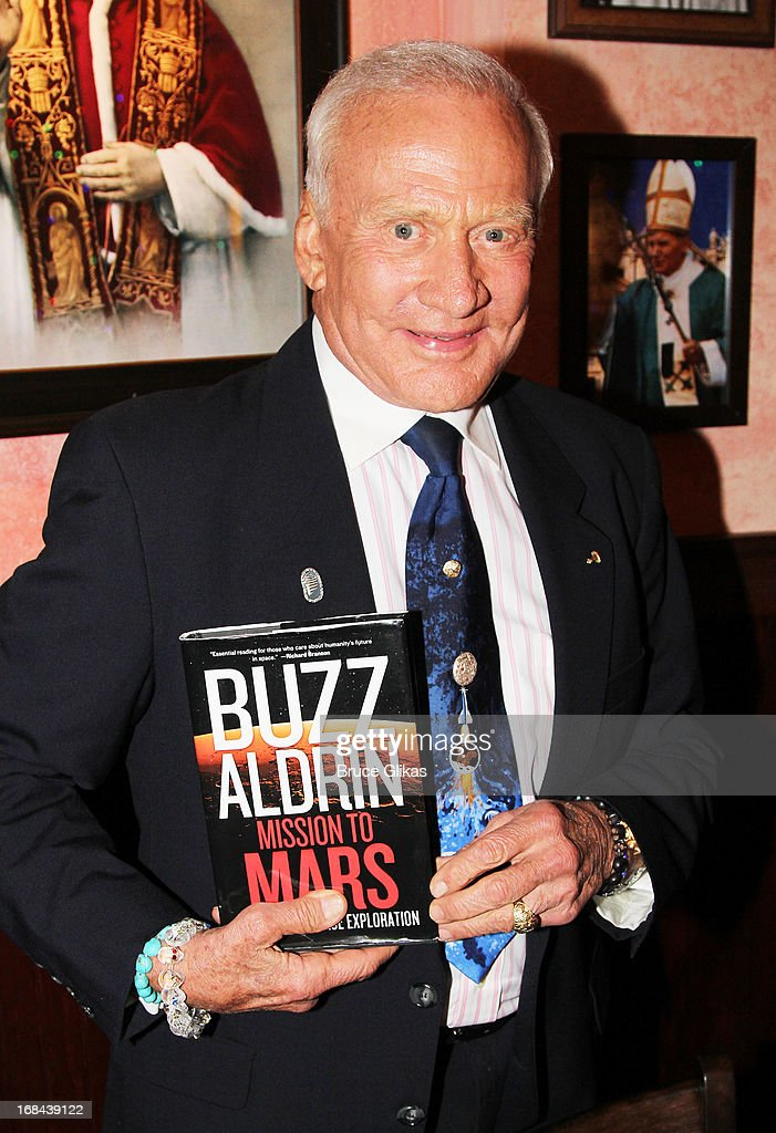 Astronaut Buzz Aldrin promotes his book 'Mission to Mars: My Vision for Space Exploration' at Buca di Beppo Times Square on May 9, 2013 in New York City.