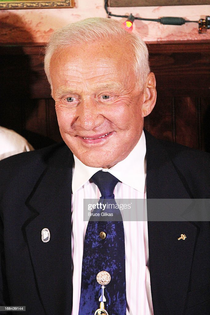 Astronaut <a gi-track='captionPersonalityLinkClicked' href=/galleries/search?phrase=Buzz+Aldrin&family=editorial&specificpeople=90480 ng-click='$event.stopPropagation()'>Buzz Aldrin</a> promotes his book 'Mission to Mars: My Vision for Space Exploration' at Buca di Beppo Times Square on May 9, 2013 in New York City.