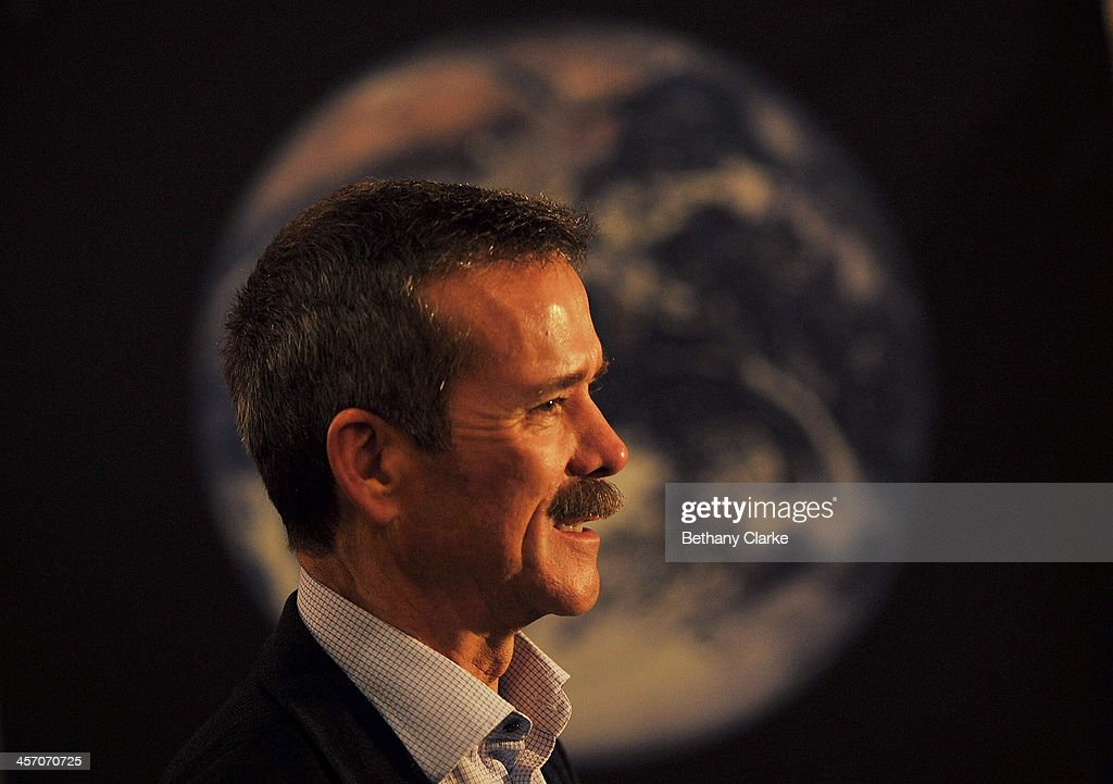 Astronaut Chris Hadfield poses for photos in front of the Apollo 10 Command Module which travelled around the Moon in 1969 on December 16, 2013 in London, England. Chris Hadfield lived aboard the International Space Station (ISS) as Commander of Expedition 35.