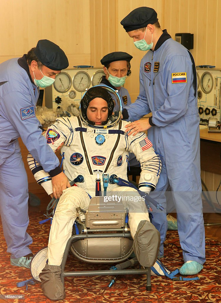 US astronaut Christopher Cassidy (C) takes part in a pre-flight training at the Russian leased Kazakhstan's Baikonur cosmodrome on March 17, 2013. The three-man crew, including Russian cosmonauts, Pavel Vinogradov , Alexander Misurkin and US astronaut Christopher Cassidy, is scheduled to blast off to the International Space Station (ISS) from Baikonur on March 29. PHOTO