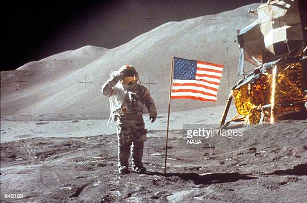 Astronaut David Scott gives salute beside the US flag July 30 1971 on the moon during the Apollo 15 mission