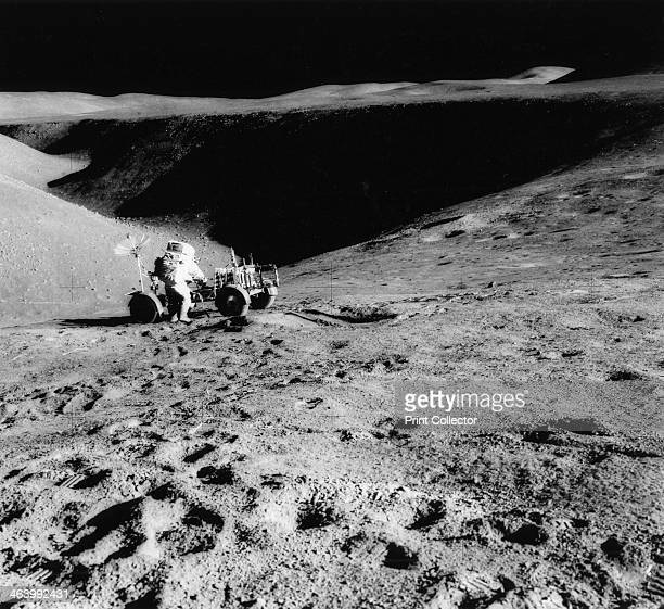 Astronaut David Scott on the slope of Hadley Delta during Apollo 15 1971 David Scott mission commander performs a task at the Lunar Roving Vehicle...