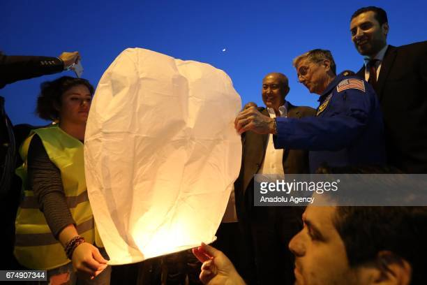 NASA astronaut Donald Thomas releases a sky lanterns up to sky during an event celebrating the anniversary of end of the Lebanese civil war in Beirut...