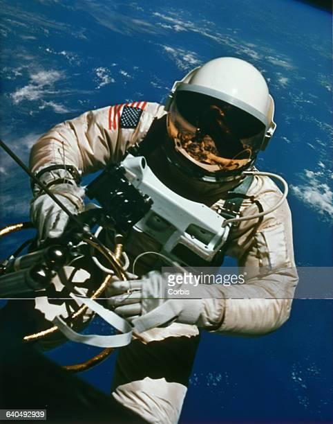 Astronaut Edward H White EVA or spacewalking outside his Gemini rocket in Earth's orbit 1965   Location above Earth