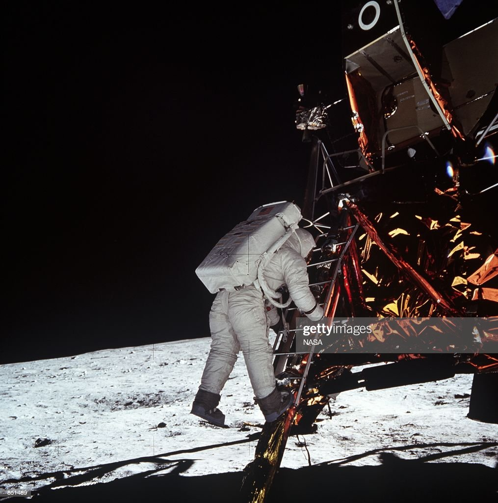 Astronaut Edwin E Aldrin Jr lunar module pilot descends the steps of the Lunar Module ladder July 20 1969 as he prepares to walk on the Moon This...