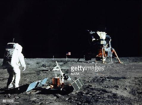 Astronaut Edwin E Aldrin Jr Lunar Module Pilot stands near a scientific experiment on the lunar surface Man's first landing on the Moon occurred July...