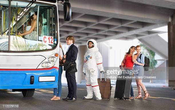 Astronaut entering a bus
