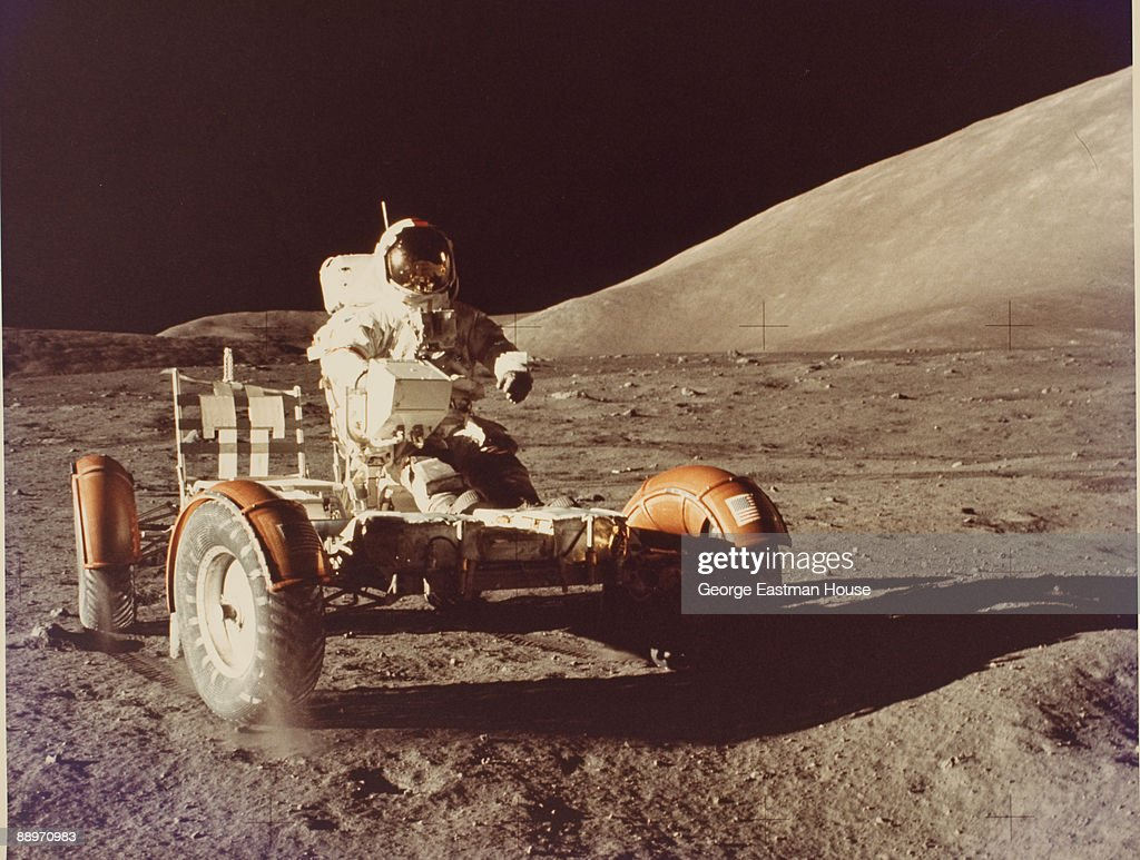 Astronaut Eugene Cernan drives the lunar roving vehicle (LVR) on the surface of the moon during the Apollo 17 mission, December 1972.