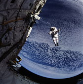 Astronaut floating near satellite, Earth in background (Enhancement)