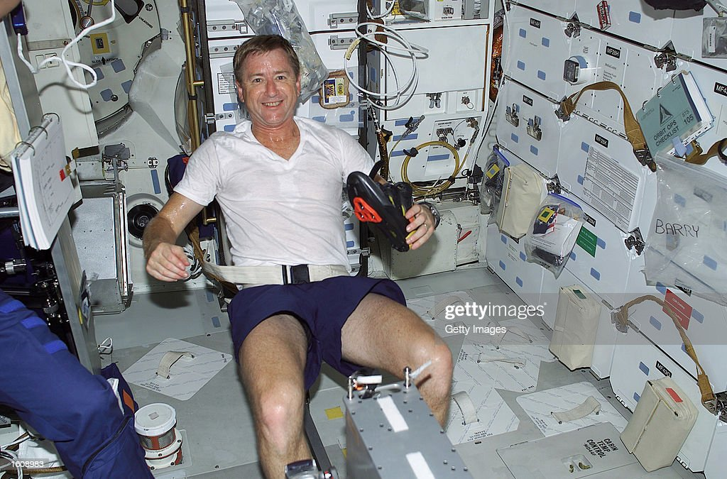 US astronaut Frank Culbertson exercises on a bicycle ergometer August 10, 2001 on the mid deck of the Space Shuttle Discovery on his way to international space station Alpha. Culbertson took command of the international space station August 13, 2001 along with two Russian cosmonauts, where he will spend the next four months.