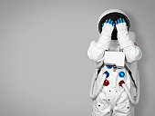 Astronaut hides his face