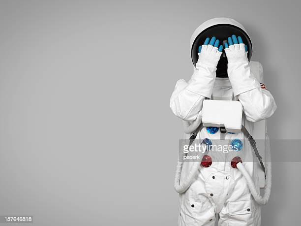 Astronaute cache son visage